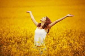 CBT and Happy Woman in yellow field