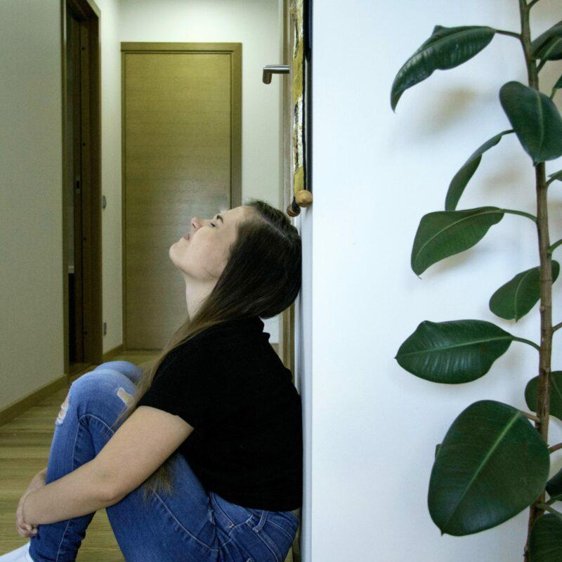 anxious woman against wall