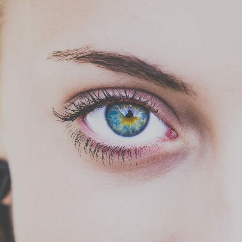 woman staring into th camera with beautiful eyes